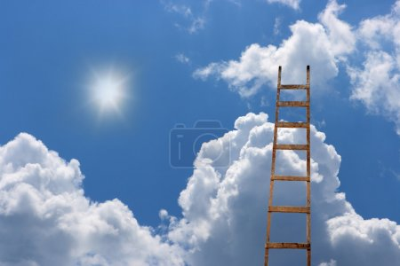 Old antique ladder to blue beautiful heaven