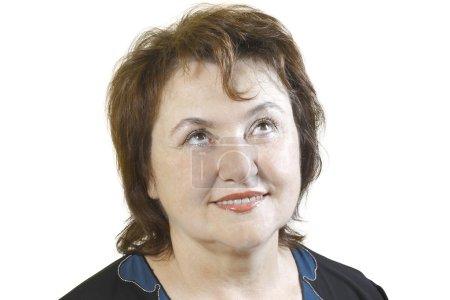 Photo pour Portrait d'une femme âgée qui lève les yeux isolé sur fond blanc - image libre de droit