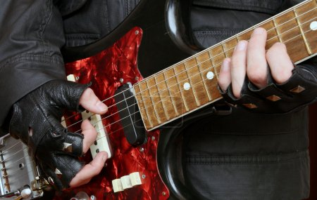 Photo for Rock musician playing on an old electric guitar - Royalty Free Image