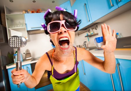 Photo for Crazy housewife in an interior of the kitchen - Royalty Free Image