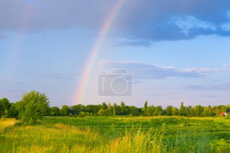 Landscape with clouds and rainbow