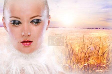 Portrait beautiful girl against the backdrop golden wheat ready