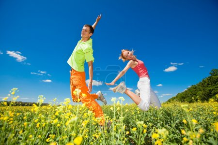 Happy is jumping in field