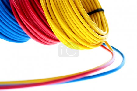 Photo for Electric wires of red, yellow and dark blue colour are winded in rings. - Royalty Free Image