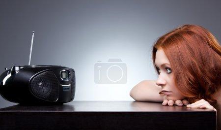 Young woman listening radio
