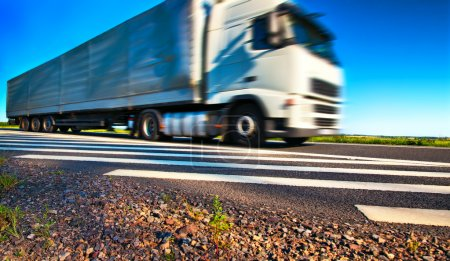 Photo for Truck transportation. Wide angle view and blurred motion effect. - Royalty Free Image