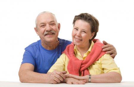 Happy senior couple against white background