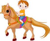 Cute little Boy riding on a horse