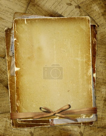 Foto de Página antigua con cintas y moño en el fondo abstracto - Imagen libre de derechos