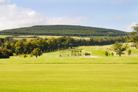 Golf course and green hills of Ireland