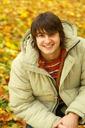 Man isolated on autumn background
