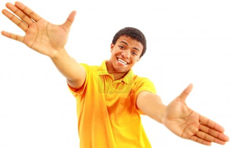 Photo for Success sign - A young man showing thumbs up sign over white background - Royalty Free Image