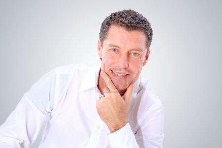 Closeup portrait of a senior man smiling on white background