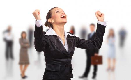 Photo pour Femme d'affaires heureuse sur un fond blanc isolé avec l'équipe d'affaires - image libre de droit
