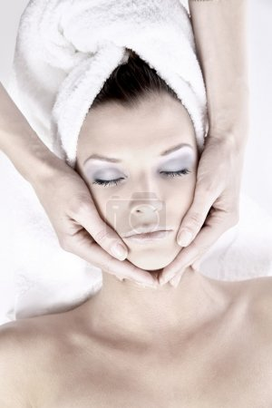 Photo for Beautiful young woman receiving facial massage - Royalty Free Image