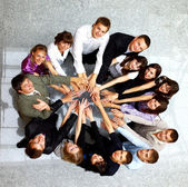 Top view of business with their hands together in a circle
