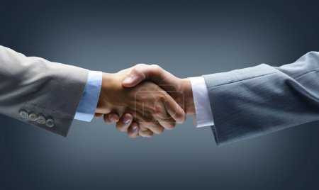 Photo for Handshake - Hand holding on black background - Royalty Free Image