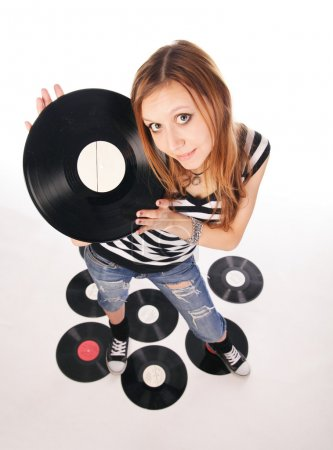 Young girl with retro disk