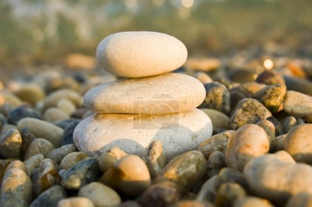 Photo for Three balanced rocks contrast a sea of stones - Royalty Free Image