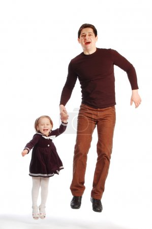 Happy father with a daughter jumping