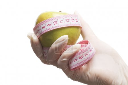 Photo for Apple and Measuring Tape in hand - Royalty Free Image
