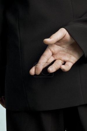 Businessman crossed fingers