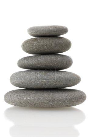 Balanced rocks on white