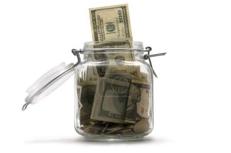 Foto de Tarro con el dinero en blanco - Imagen libre de derechos
