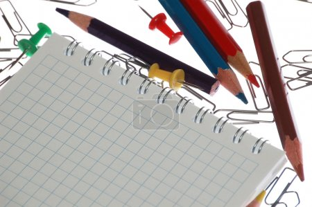 Note and pencils with staples