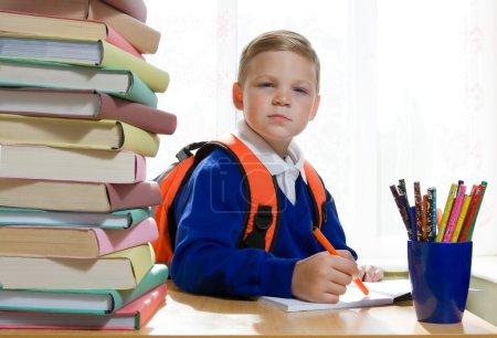 School boy sitting at the desk