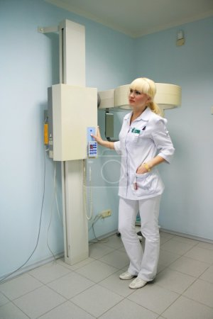 Doctor connects the x-rays equipment