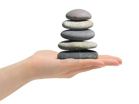 Photo pour Pile de pierres dans la main isolé sur fond blanc - image libre de droit