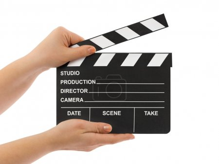 Cinema clapboard in hands isolated on white backgr...