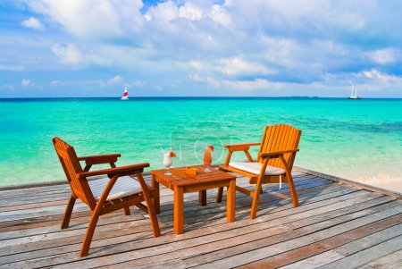 Photo for Two cocktails on table, beach cafe, sea background - Royalty Free Image