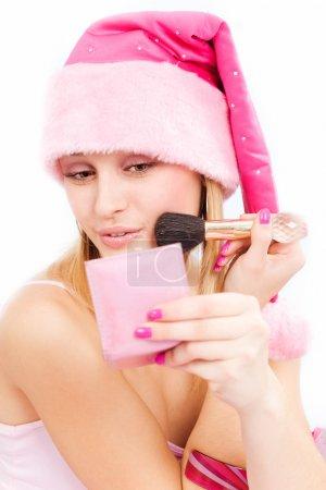 Photo pour Santa helper fille maquillage à la fête de Noël - image libre de droit