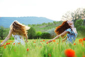 Girls in spring field