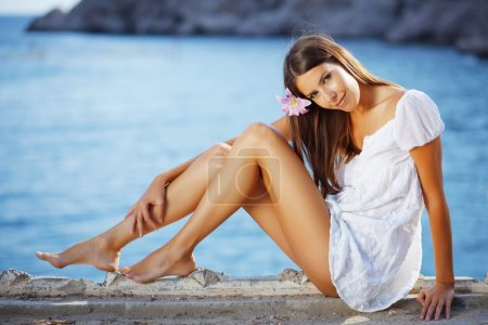 Portrait of beautiful brunette woman with long leg...
