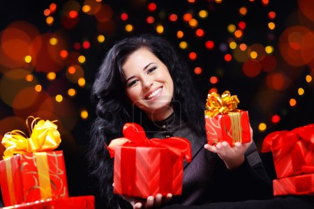 Cute woman with presents at night