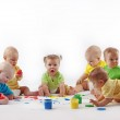 Group of babies painting on white background...