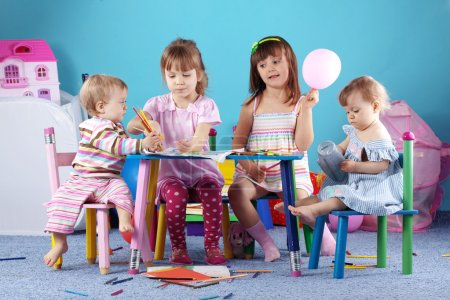 Photo for Group of kids playing in the kindergarten - Royalty Free Image