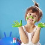 Happy Child painting in the kindergarten...