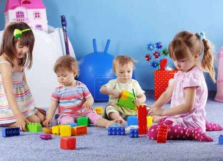 Photo for Group of kids playing with constructor - Royalty Free Image