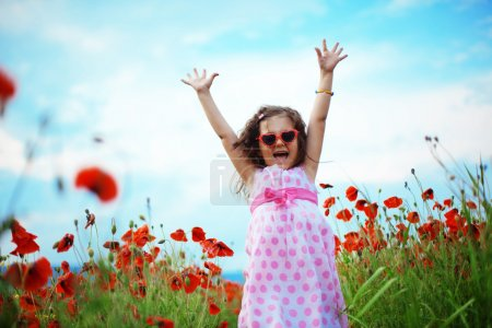 Photo for Cute child girl in poppy field - Royalty Free Image