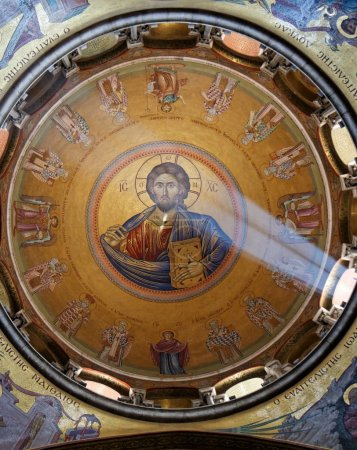 Sunlit painting of Jesus Christ on done of Church of the Holy Sepulchre in