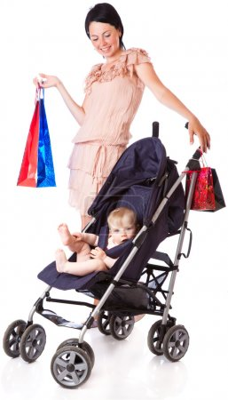 Photo for A young woman is standing near her child in a pram. isolated on a white background - Royalty Free Image