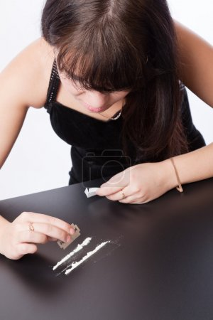 Girls are sniffing cocaine (imitation)