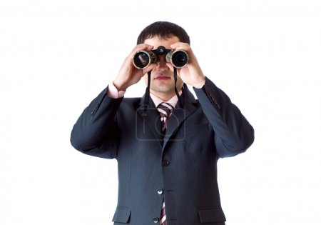 A man is looking through the binoculars