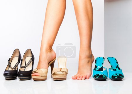 Photo for Female legs in fashion shoes. isolated on a white background - Royalty Free Image