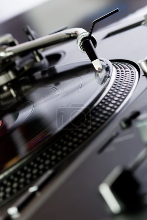 Photo for Turntable playing a record with music in the club - Royalty Free Image