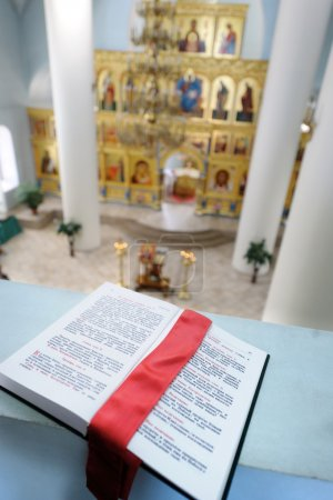 Orthodox Holy Bible on the table agains the sanc